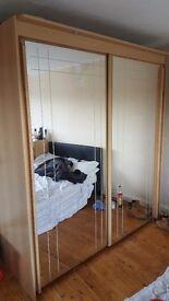 2 Sliding mirrored door wardrobe. Great quality not cheap!