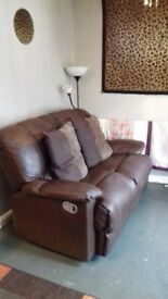 Two and three seater recliner sofas brown leather