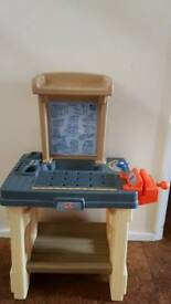 """Child's workbench step2 with some tools and some fake """"wood"""""""