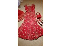 Red and gold wedding dress lengha