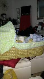 Baby clothes and mosses basket