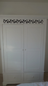 White wooden wardrobe