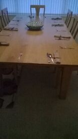 SOLID OAK DINING TABLE AND EIGHT CHAIRS HANDCRAFTED IN PEMBROKESHIRE. [ PRICE REDUCTION ].
