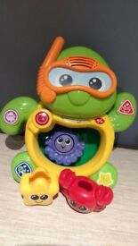 Vtech turtle bath toy and Jake the pirate bath toy boat