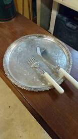 Silver plated tray with knife and fork