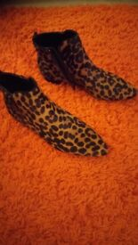 Leather leopard print ankle boots.