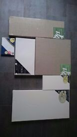 Assortment of new blank art canvases