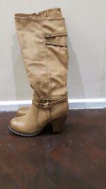 Tan leather boots. Never worn. Size 6.