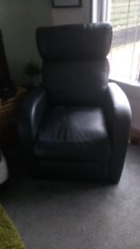 Black recliner chair. Usual wear and tear few scratches. But still looks good