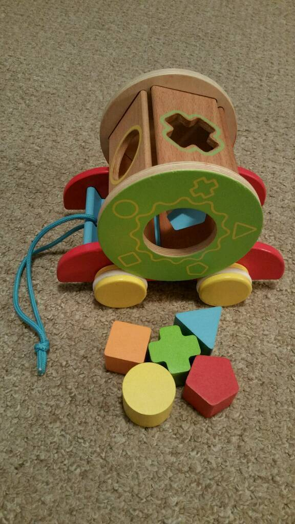 Ikea bead roller coaster and a wooden toy