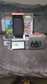 Nintendo switch, 2x games, hard case and racing wheels