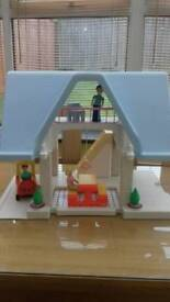 Little Tikes dolls house with furniture, figures and car.