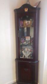Corner wooden cabinet.