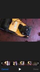 Petrol self propelled mower