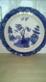 Box full of Wedgewood plates and bowls around 50 to 100 years old.