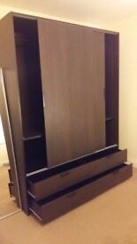 Dark brown Trysil Ikea Wardrobe w. 2 sliding doors, 2 shelves and 4 drawers. Perfect condition. W12.