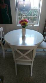 White solid wood table and chairs