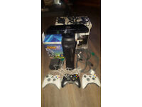 xbox 360 elite black with over 75 games and kenict bar