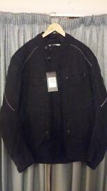 Brand New Triumph Textile Motorcycle Jacket Phantom. Never been worn size XXXL.