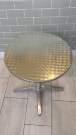 7 Silver bistro tables and 2 bar tables