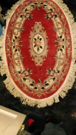 Oval Red Patterned Woollen Rug 5.8ft x 3.8ft