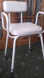 Shower chair, adjustable height.