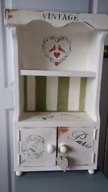 "Shabby chic cabinet hand painted and designed. Two opening doors and shelves. 24"" high"