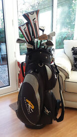 set of golf clubs and electic trolly
