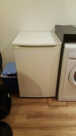 White front door freezer with drawers.
