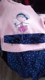 2 black bags of baby girl clothes 0-3 and 3-6