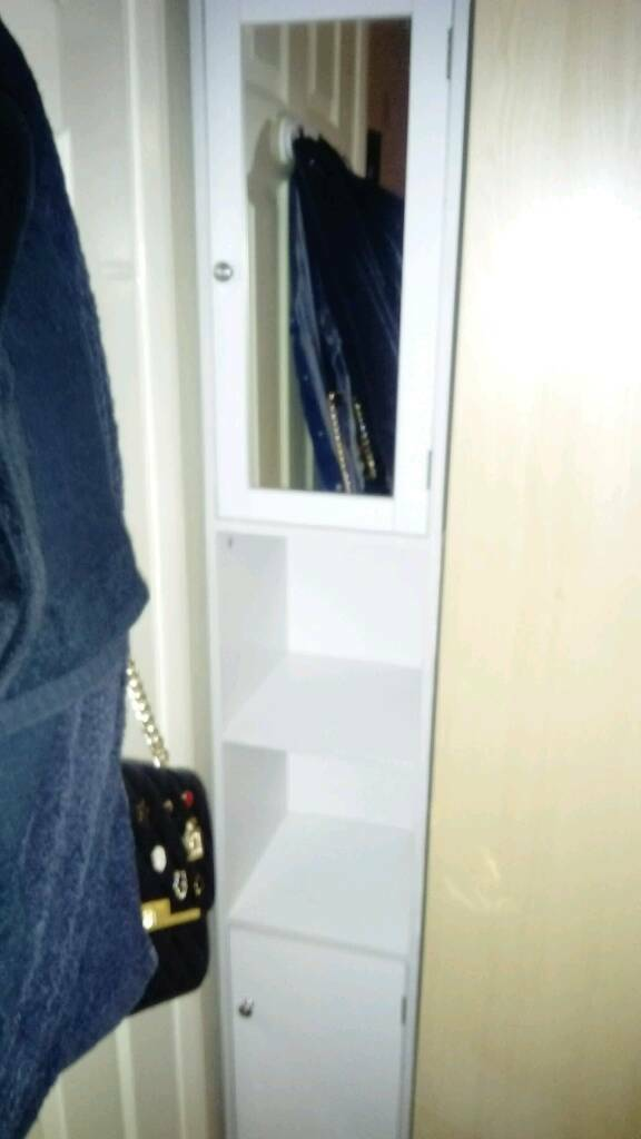 White tall bathroom cabinet with glass mirror door