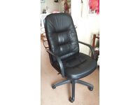 Computer chair. Black leather high back with up and down feature.
