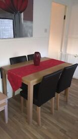 Pine table and 4 brown leather chairs