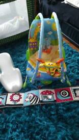 Baby bundle, tiny love baby bouncer chair, bath seat and double sided cot bumper.