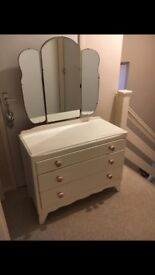 Chest of drawers with attached mirror