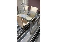 Glass Table & 4 Chairs £100