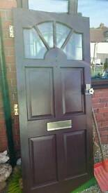 Hard wood front door with glass panels