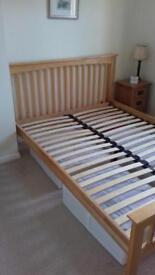 Hardwood double bed with sprung slats