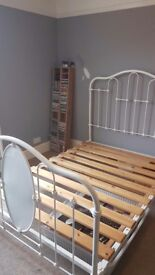 Double bed and wooden base. £65 ono