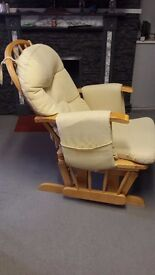 Gliding/feeding chair with foot rest