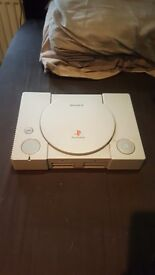 Sony playstation 1 with controller and 6 games