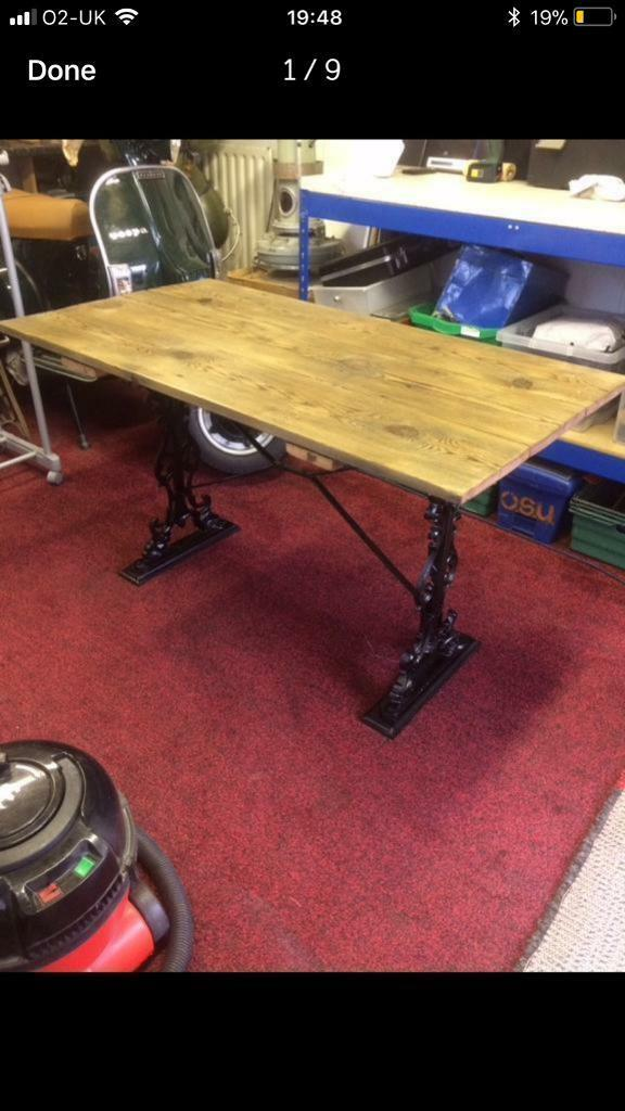 Beautiful cast iron and reclaimed wooden table