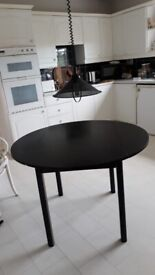 Round black wooden drop leaf extendable dining table seats 4