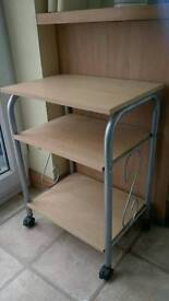 Small side table with lockable wheels