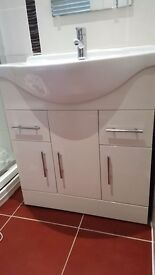 White bathroom sink with storage unit