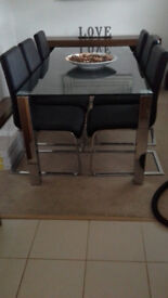 Dinning table and 6 black leather chairs