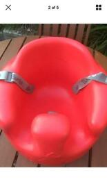 Red bumper seat with straps