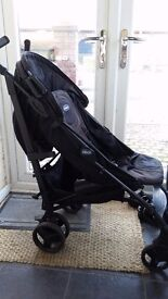 Black Chicco Stroller with matching foot muff