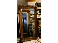 Huge gilt mirror.