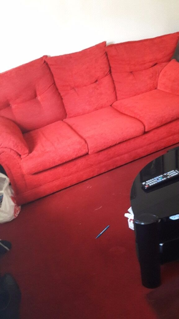 Three seater and two seater sofas poppy red